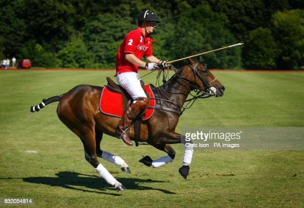 Prince Harry returns to get a replacement for his broken mallet as he plays polo for the Army at the Rundle Cup Day in Tidwoth Wiltshire