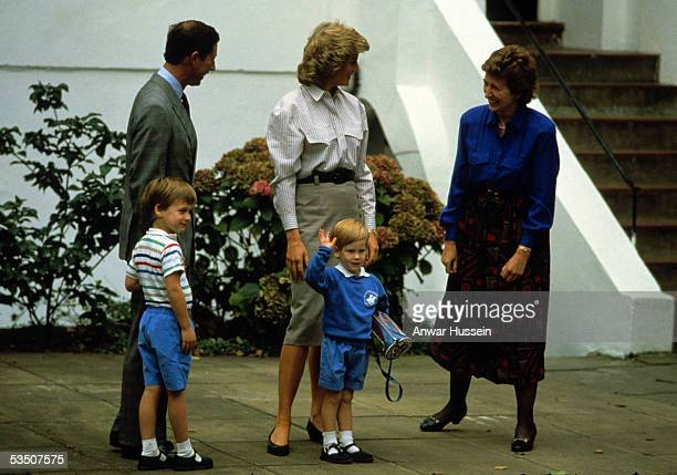 Prince Harry salutes as he arrives to attend his first day at nursery school with Charles Prince of Wales Diana Princess of Wales and his brother...
