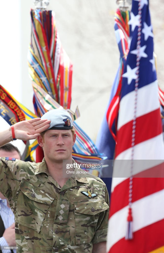 Prince Harry salutes as he attends the Opening Ceremony of the Warrior Games during the third day of his visit to the United States on May 11, 2013 in Colorado Springs, Colorado. HRH will be undertaking engagements on behalf of charities with which the Prince is closely associated on behalf also of HM Government, with a central theme of supporting injured service personnel from the UK and US forces.