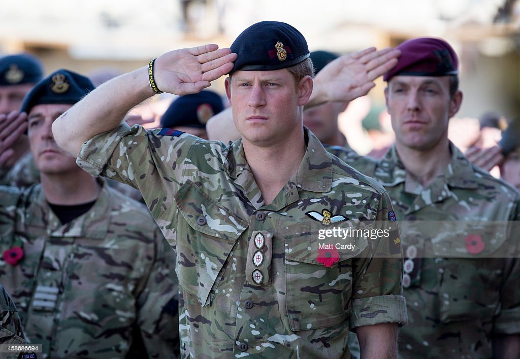 Prince Harry salutes as the Last Post is played as he joins British troops and service personal remaining in Afghanistan and also International Security Assistance Force (ISAF) personnel and civilians as they gather for a Remembrance Sunday service at Kandahar Airfield November 9, 2014 in Kandahar, Afghanistan. As the UK combat mission in Afghanistan draws to an end in 2014 this year, which also marks the 100th anniversary of the start of World War One, 70 years since the D-Day landings will be the last time British service personal will gather in any great numbers in the south of the country.