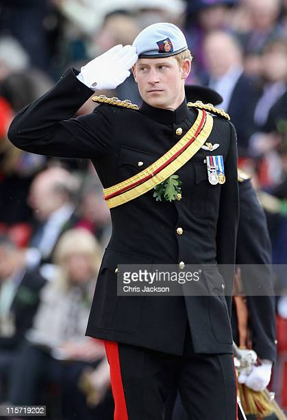 Prince Harry salutes Chelsea Pensioners as he attends the Founder's Day Parade at the Royal Hospital Chelsea on June 9 2011 in London England The...