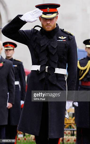 Prince Harry salutes during a Service in the Field of Remembrance at Westminster Abbey on November 5 2015 in London England