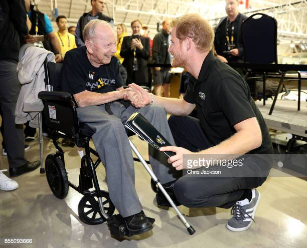 Prince Harry shakes hands with 102 year old WW2 veteran Norm Baker at the Invictus Games 2017 on September 28 2017 in Toronto Canada