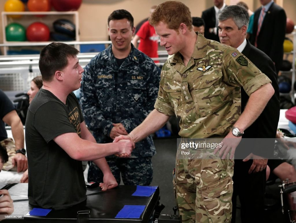 Prince Harry shakes hands with a wounded soldier during his visit to the Military Advanced Training Center at Walter Reed National Military Medical Center treating wounded soldiers undergoing physical therapy on May 10, 2013 in Bethesda, Maryland. HRH will be undertaking engagements on behalf of charities with which the Prince is closely associated on behalf also of HM Government, with a central theme of supporting injured service personnel from the UK and US forces.