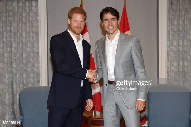 Prince Harry shakes hands with Canadian Prime Minister Justin Trudeau ahead of the Invictus Games 2017 at the Royal York Hotel on September 23 2017...
