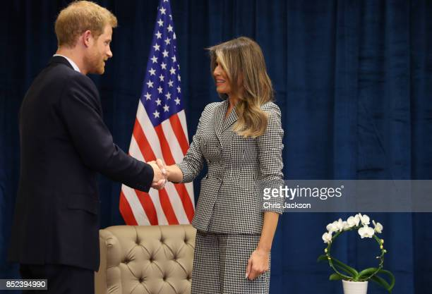 Prince Harry shakes hands with US first lady Melania Trump while meeting her for the first time as she leads the USA team delegation ahead of the...