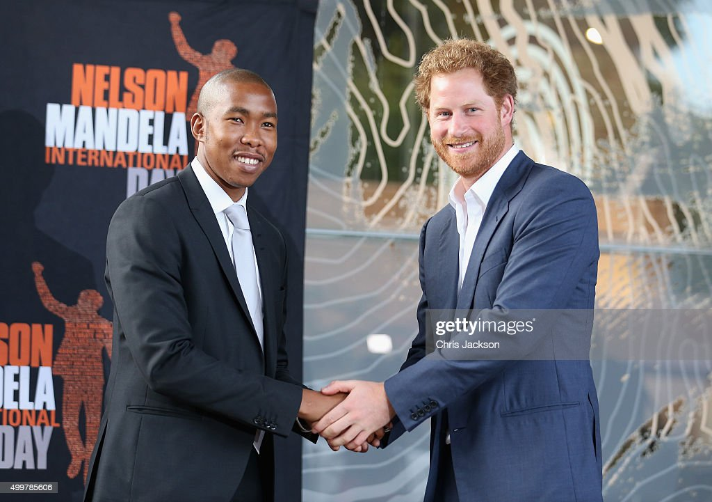 Prince Harry shakes the hand of Nelson Mandela's grandson, Mbuso Mandela at the Nelson Mandela Foundation Centre of Memory on December 3, 2015 in Johannesburg, South Africa. Prince Harry is visiting South Africa as part of a Royal Tour that has included the Opening of a new Charity Centre for children in Lesotho (Sentebale's Mamohato Children's Centre) and includes stops in Durban, Cape Town, Kruger National Park and Johannesburg.