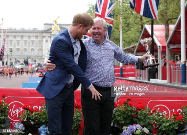 Prince Harry shares a joke with Brendan Foster during the Virgin Money London Marathon London PRESS ASSOCIATION Picture date Sunday April 23 2017 See...