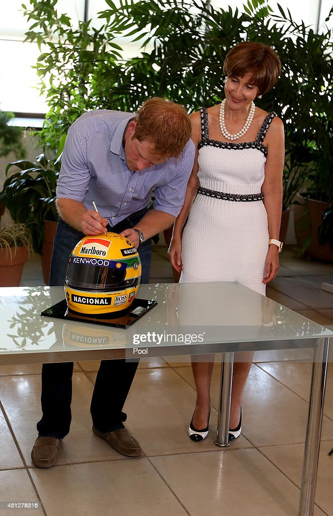 <a gi-track='captionPersonalityLinkClicked' href=/galleries/search?phrase=Prince+Harry&family=editorial&specificpeople=178173 ng-click='$event.stopPropagation()'>Prince Harry</a> signs a replica Ayrton Senna helmet accompanied by Ayrton Senna's sister, Vivienne Senna, at the Ayrton Senna Institue on June 26, 2014 in Sao Paulo Brazil. <a gi-track='captionPersonalityLinkClicked' href=/galleries/search?phrase=Prince+Harry&family=editorial&specificpeople=178173 ng-click='$event.stopPropagation()'>Prince Harry</a> is on a four day tour of Brazil that will be followed by two days in Chile.