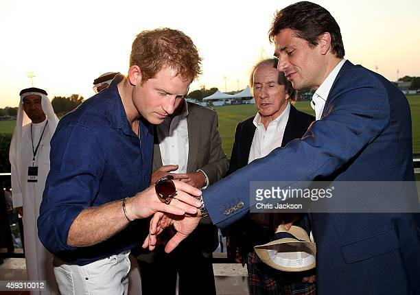 Prince Harry Sir Jackie Stewart and Arnaud Boetsch Communication Image Director of Rolex attend the Sentebale Polo Cup presented by Royal Salute...