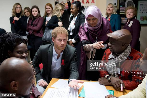 Prince Harry sits down to speak with staff volunteers and associated partners on a training course at the Leicestershire Aids Support Service on...