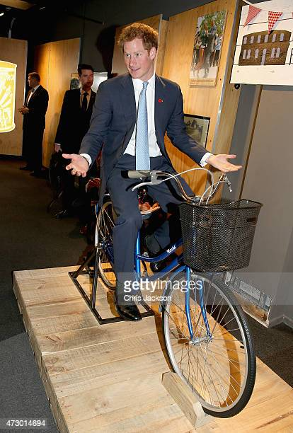Prince Harry sits on a bike which was used by people from Christchurch to get around after the 2011 earthquake during a visit to the 'Quake City'...