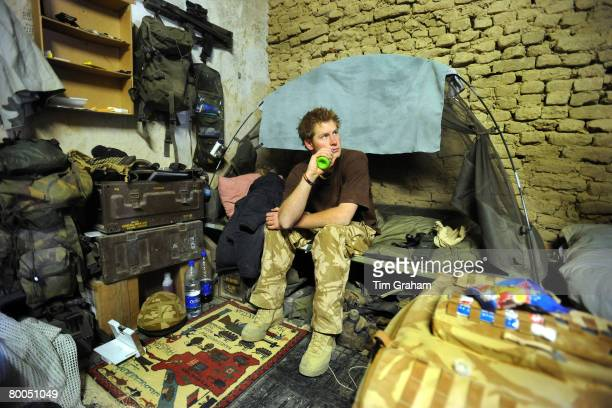 Prince Harry sits on his camp bed in his accommodation at FOB Delhi on January 2 2008 in Helmand province Southern Afghanistan
