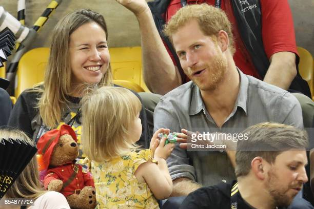 Prince Harry sits with David Henson's wife Hayley Henson and daugther Emily Henson at the Sitting Volleyball Finals during the Invictus Games 2017 at...