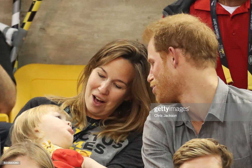 Prince Harry (R) sits with David Henson's wife Hayley Henson (L) and daugther Emily Henson at the Sitting Volleyball Finals during the Invictus Games 2017 at Mattamy Athletic Centre on September 27, 2017 in Toronto, Canada.