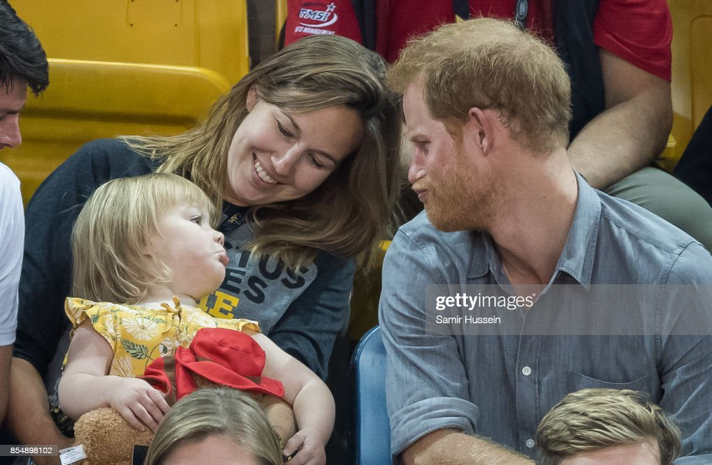 Prince Harry (R) sits with David Henson's wife Hayley Henson (L) and daugther Emily Henson at the Sitting Volleyball Finals on day 5 of the Invictus Games Toronto 2017 on September 27, 2017 in Toronto, Canada. The Games use the power of sport to inspire recovery, support rehabilitation and generate a wider understanding and respect for the Armed Forces.