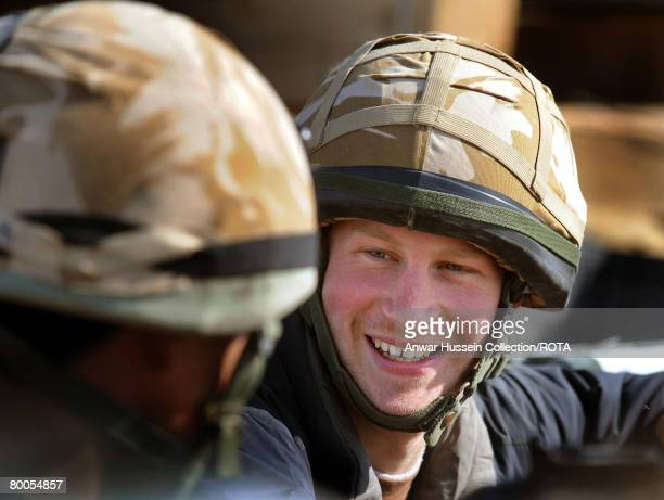 Prince Harry sits with Gurkha soldiers after he fires a 50mm machine gun at Taliban fighters on January 2 2008 in Helmand Province Afghanistan