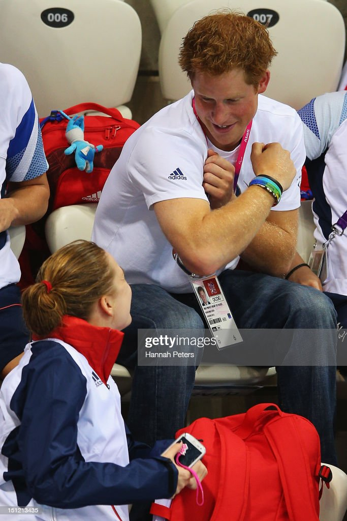<a gi-track='captionPersonalityLinkClicked' href=/galleries/search?phrase=Prince+Harry&family=editorial&specificpeople=178173 ng-click='$event.stopPropagation()'>Prince Harry</a> sits with the Great Britain swimming team on day 6 of the London 2012 Paralympic Games at Aquatics Centre on September 4, 2012 in London, England.