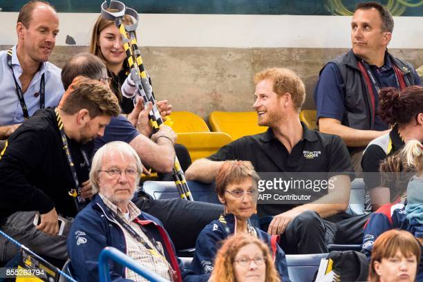 Prince Harry smiles as he watches the wheelchair rugby match between Britain and Australia at the Invictus Games for wounded soldiers and veterans in...