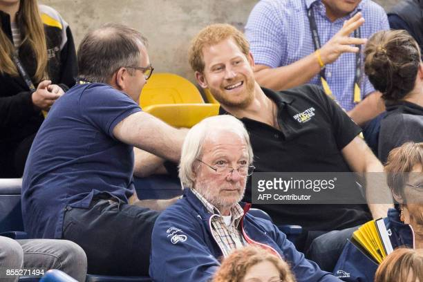 Prince Harry smiles as he watches the wheelchair rugby match between the United States and Denmark at the Invictus Games for wounded soldiers and...