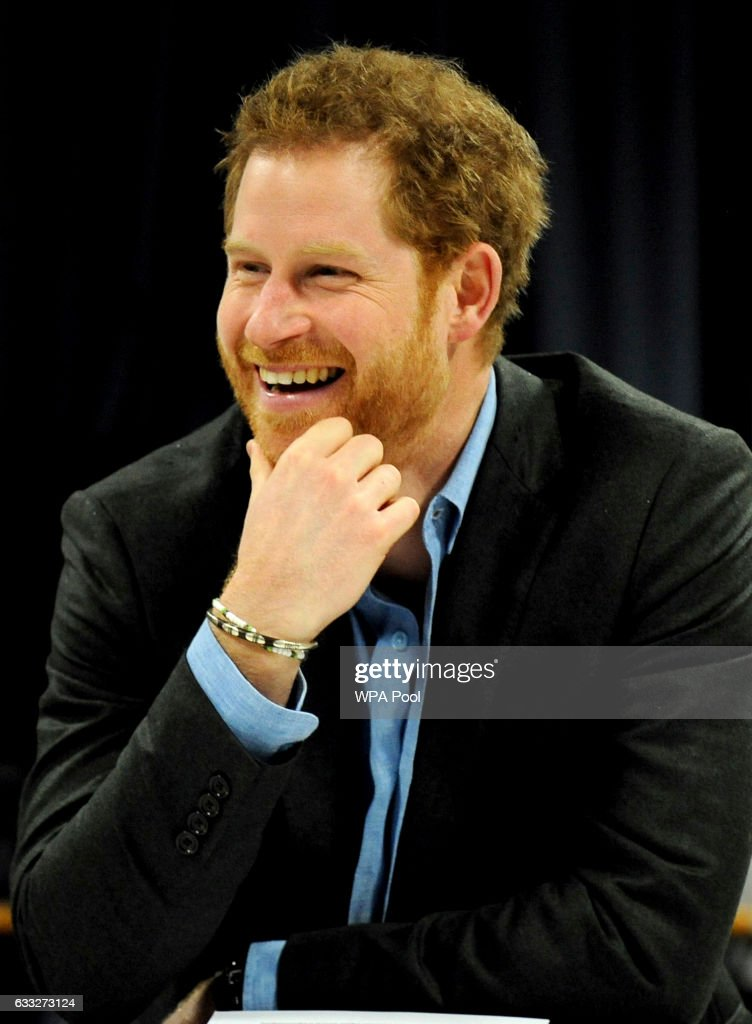 prince-harry-smiles-during-a-meeting-with-teachers-and-tutors-during-picture-id633273124