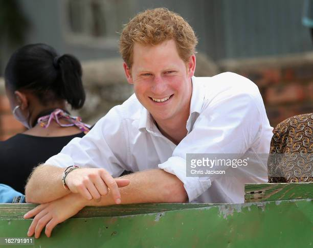 Prince Harry smiles during a visit to St Bernadette's Centre for the blind a project supported by his charity Sentebale on February 27 2013 in Maseru...