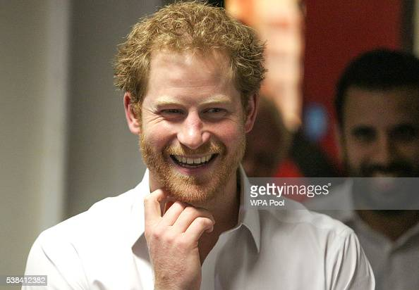 Prince Harry smiles during a visit to the Double Jab Boxing Club to support Sport for Social Development initiatives on June 6 2016 in London United...
