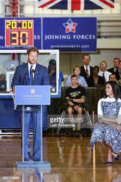 Prince Harry speaks as First Lady Michelle Obama listens during the Joining Forces Invictus Games Event at Wells Field House on October 28 2015 in...