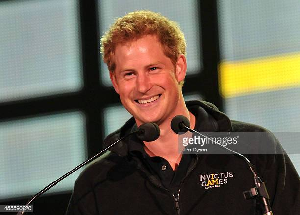 Prince Harry speaks on stage at the Invictus Games Closing Concert at Queen Elizabeth Olympic Park on September 14 2014 in London United Kingdom