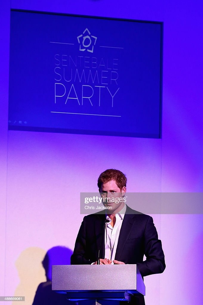 Prince Harry speaks on stage during the Sentebale Summer Party at the Dorchester Hotel on May 7, 2014 in London, England.