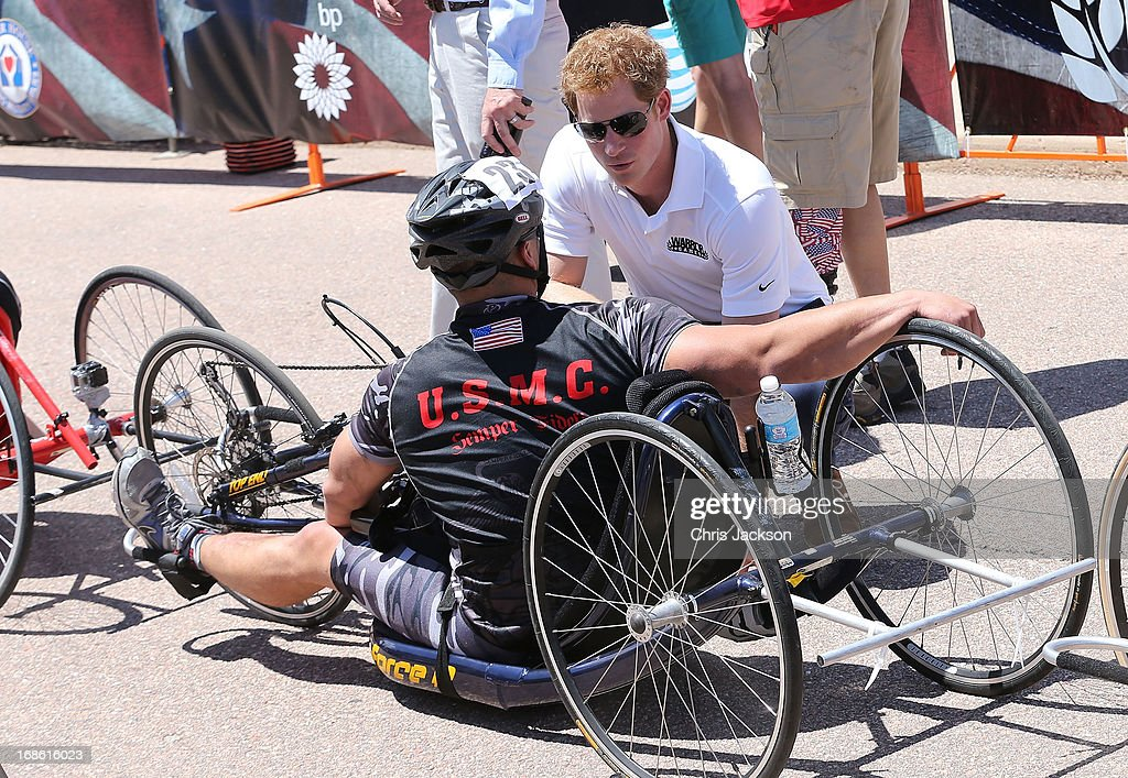 <a gi-track='captionPersonalityLinkClicked' href=/galleries/search?phrase=Prince+Harry&family=editorial&specificpeople=178173 ng-click='$event.stopPropagation()'>Prince Harry</a> speaks to competitors as he attends the US airforce training academy hand cycling event at the Warrior Games during the fourth day of his visit to the United States on May 12, 2013 in Colorado Springs, Colorado. HRH will be undertaking engagements on behalf of charities with which the Prince is closely associated on behalf also of HM Government, with a central theme of supporting injured service personnel from the UK and US forces.
