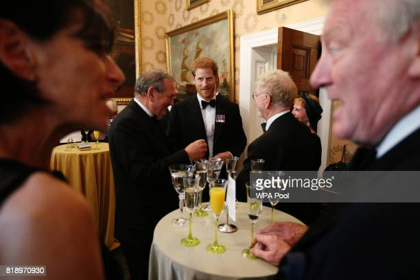 Prince Harry speaks to guests during a reception at Trinity House in London for Project Vernon a campaign to install a monument dedicated to the...