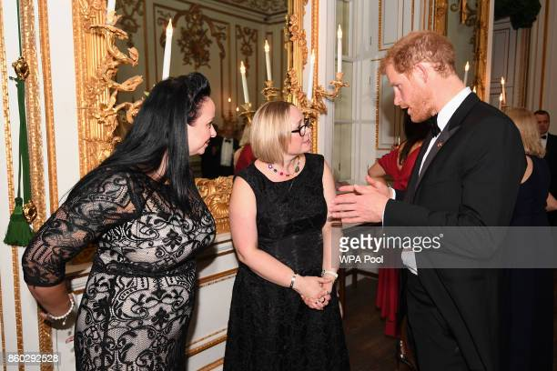 Prince Harry speaks to Jill Evans who has been supported by WellChild while caring for her son Noah six who has a rare lung condition as he attends...