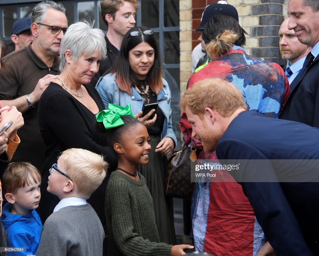 prince-harry-speaks-to-young-children-during-a-visit-to-the-newly-picture-id842942534