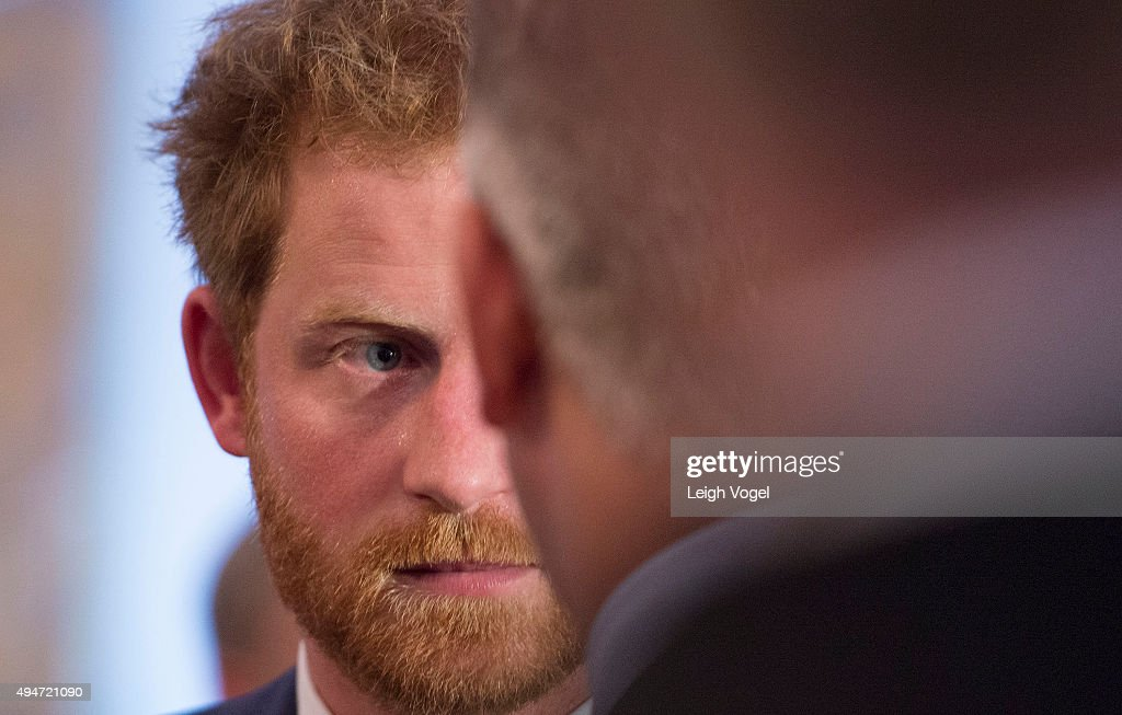 Prince Harry speaks with attendees of the Invictus Games 2016 Reception at the British Ambassador's Residence on October 28, 2015 in Washington, DC.