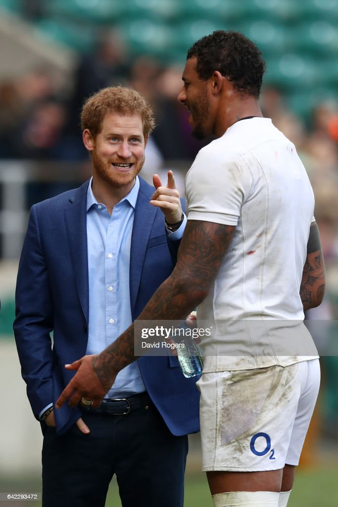Prince Harry speaks with Courtney Lawes during an England open training session at Twickenham Stadium on February 17, 2017 in London, England.