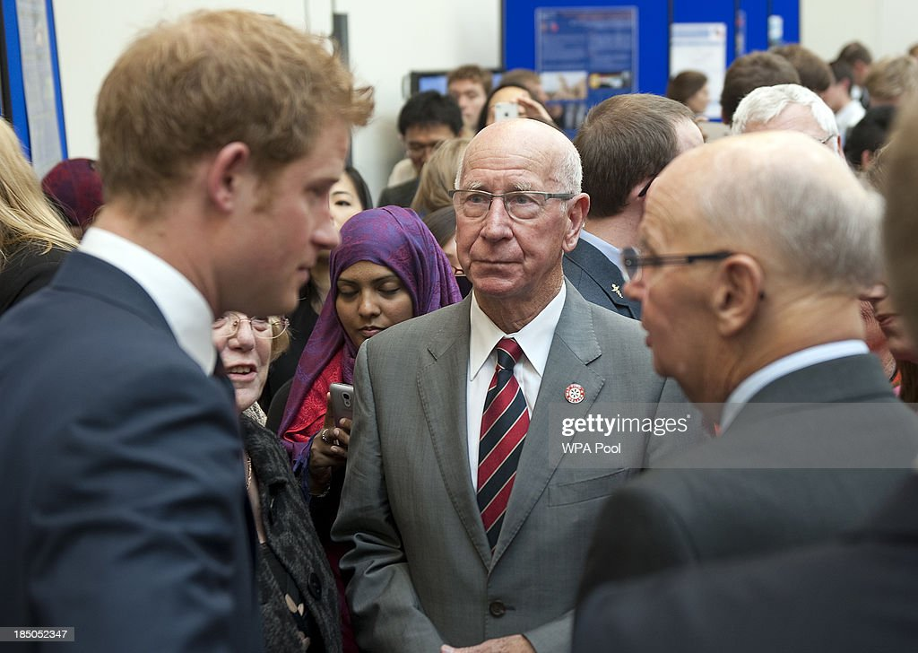 <a gi-track='captionPersonalityLinkClicked' href=/galleries/search?phrase=Prince+Harry&family=editorial&specificpeople=178173 ng-click='$event.stopPropagation()'>Prince Harry</a> speaks with guests including former footballer Sir <a gi-track='captionPersonalityLinkClicked' href=/galleries/search?phrase=Bobby+Charlton&family=editorial&specificpeople=204207 ng-click='$event.stopPropagation()'>Bobby Charlton</a> during the official opening of the Royal British Legion Centre for Blast Injury Studies at Imperial College London on October 17 in London, England.