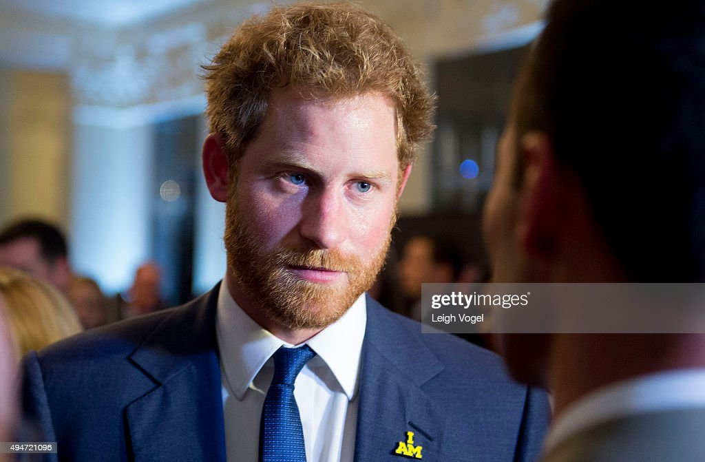 Prince Harry speaks with guests of the Invictus Games 2016 Reception at the British Ambassador's Residence on October 28, 2015 in Washington, DC.