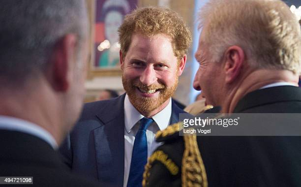 Prince Harry speaks with guests of the Invictus Games 2016 Reception at the British Ambassador's Residence on October 28 2015 in Washington DC