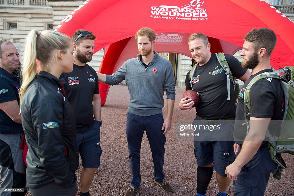 Prince Harry speaks with members of the Walking With The Wounded team in the forecourt of Buckingham Palace after their latest endeavour, the Walk Of Britain on November 1, 2015 in London, England. Six members of the Walk of Britain team concluded their 1000-mile trek, which began on 22 August in Scotland and continued through the length and breadth of the country to London.