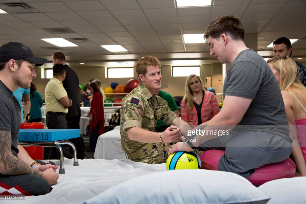 <a gi-track='captionPersonalityLinkClicked' href=/galleries/search?phrase=Prince+Harry&family=editorial&specificpeople=178173 ng-click='$event.stopPropagation()'>Prince Harry</a> speaks with Staff Sgt. Timothy Payne (R), who lost his legs in an IED explosion in Afghanistan during his visit to the Military Advanced Training Center at Walter Reed National Military Medical Center treating wounded soldiers undergoing physical therapy on May 10, 2013 in Bethesda, Maryland. HRH will be undertaking engagements on behalf of charities with which the Prince is closely associated on behalf also of HM Government, with a central theme of supporting injured service personnel from the UK and US forces.