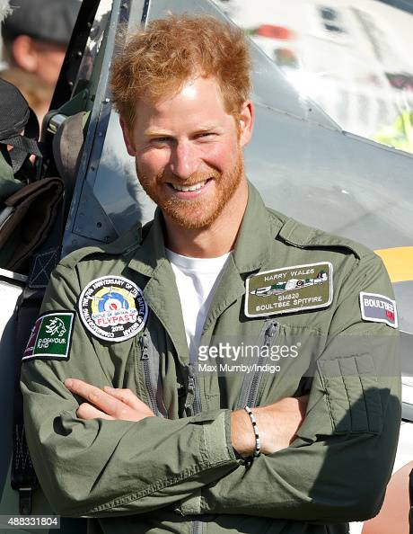Prince Harry stands alongside a Spitfire Aircraft at Goodwood Aerodrome following a Battle of Britain Flypast on September 15 2015 in Chichester...