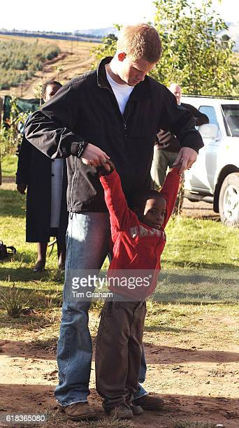 APRIL 28 2006*** Prince Harry stands with his old friend Mutsu Potsane in the grounds of the Mants'ase children's home while on a return visit to...