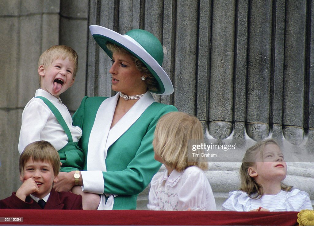 Prince Harry Sticking His Tongue Out Much To The Suprise Of His Mother, Princess Diana At Trooping The Colour With Prince William, Lady Gabriella Windsor And Lady Rose Windsor Watching From The Balcony Of Buckingham Palace