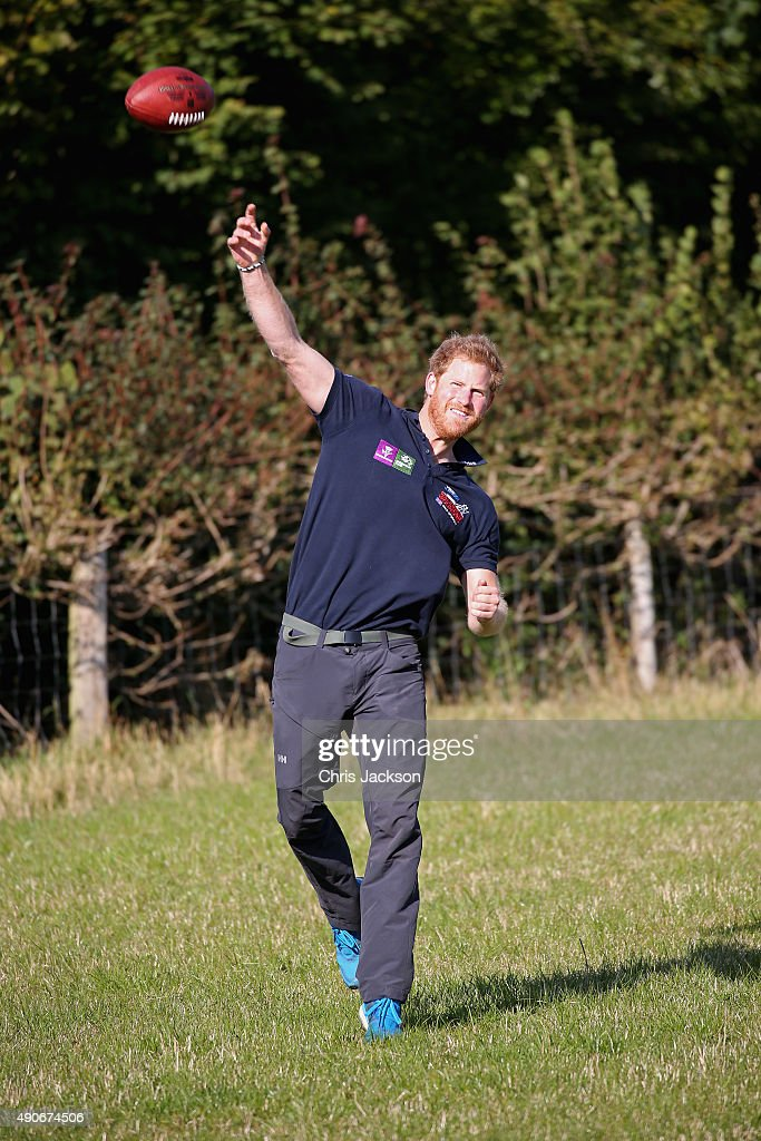 Prince Harry takes a break to play some American Football with NFL representative Dan Marino (NFL support the Walk of Britain) on the route to Ludlow with Walking with the Wounded's Walk of Britain team on September 30, 2015 in Ludlow, England. Prince Harry is patron of the expedition and walked today as part of the veteran's 1000 mile, 72 day expedition through the UK mainland.