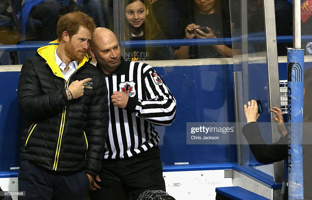 Prince Harry takes a photo with the referee as he watches a sledge-hockey match Mattany at the Athletic Centre on May 2, 2016 in Toronto, Canada. Prince Harry is in Toronto for the Launch of the 2017 Toronto Invictus Games before heading down to Miami and the 2016 Invictus Games in Orlando.