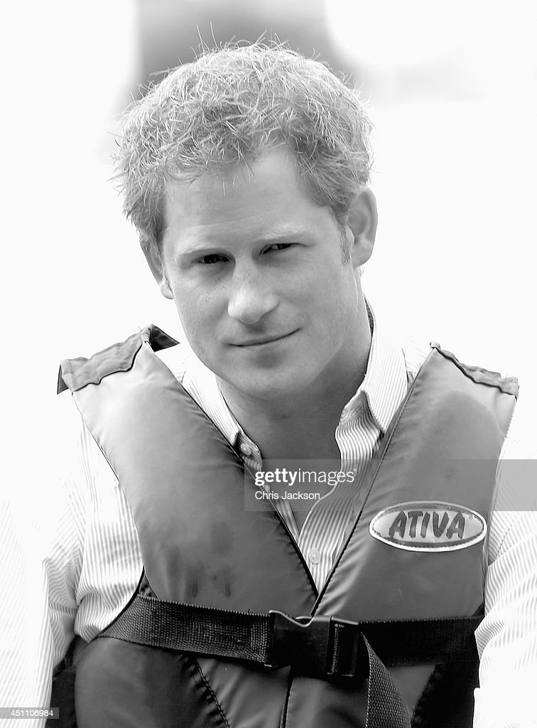 Prince Harry takes part in a canoe rehabilitation therapy session at the Rede Sarah Hospital for Nerological Rehabilitation injuries on Lake Paranoa on June 23, 2014 in Brasilia, Brazil. Prince Harry is on a four day tour of Brazil that will be followed by Two days in Chile.
