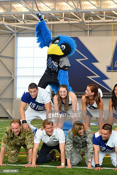 Prince Harry takes part in a cheerleading display helping to form the bottom of the pyramid at the United States Air Force Academy's football...