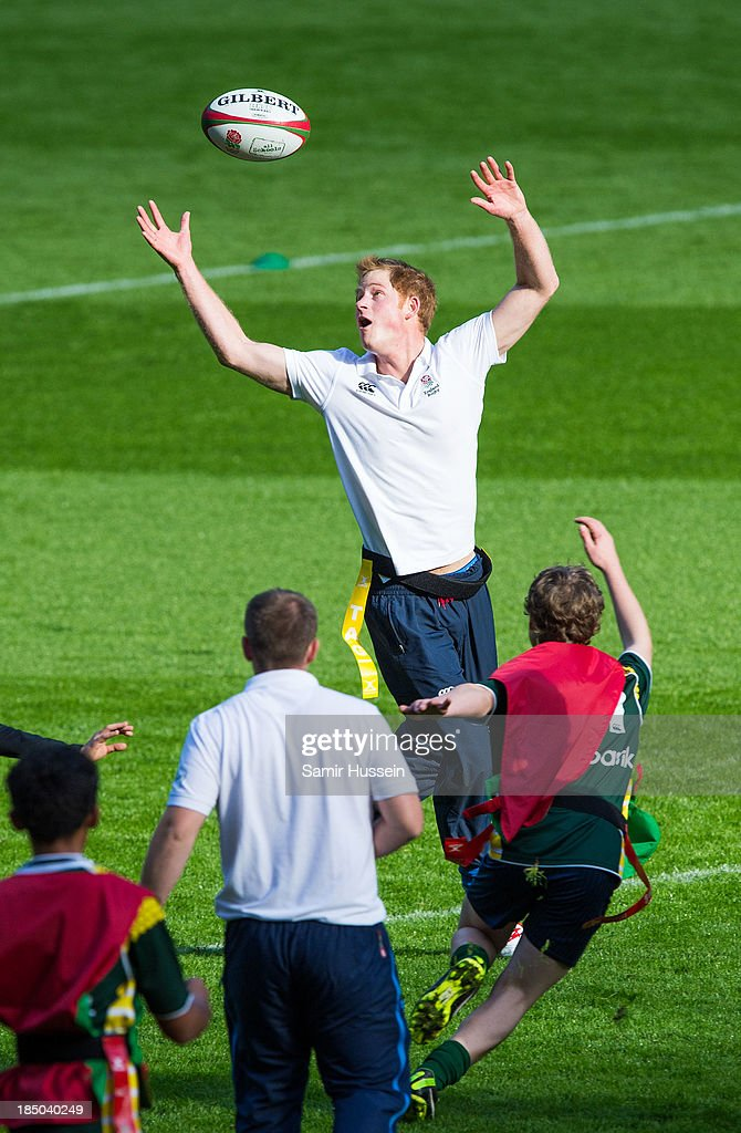 <a gi-track='captionPersonalityLinkClicked' href=/galleries/search?phrase=Prince+Harry&family=editorial&specificpeople=178173 ng-click='$event.stopPropagation()'>Prince Harry</a> takes part in a rugby training game as he attends RFU All School Programme Coaching Event at Twickenham Stadium on October 17, 2013 in London, England.