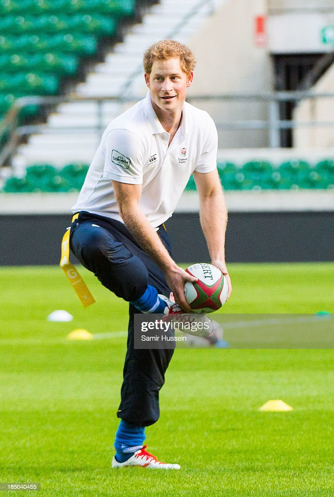 Prince Harry takes part in a rugby training game as he attends RFU All School Programme Coaching Event at Twickenham Stadium on October 17, 2013 in London, England.